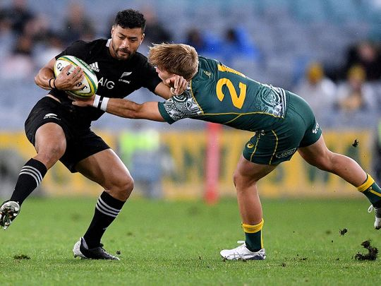 New Zealand's Richie Mo'unga in action with Australia's Tate McDermott