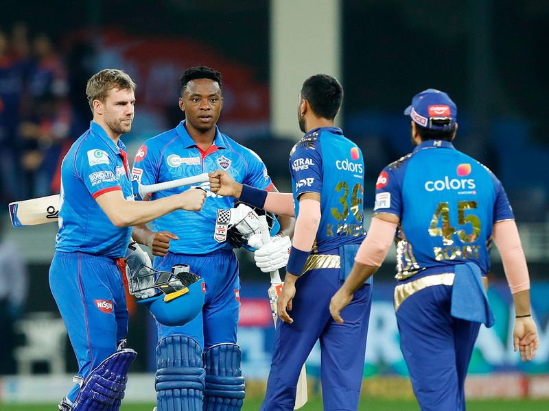 Mumbai and Delhi players greet each other