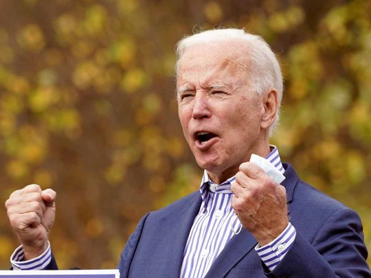 US president-elect Joe Biden speaks during a drive-in campaign event at Bucks County Community College in Bristol, Pennsylvania, US, October 24, 2020.