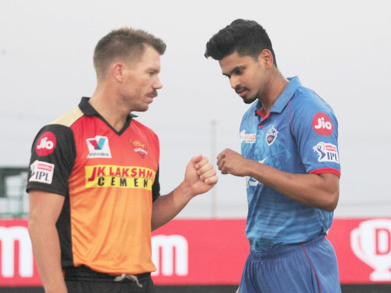 Delhi skipper Shreyas Iyer (right) with Hyderabad captain David