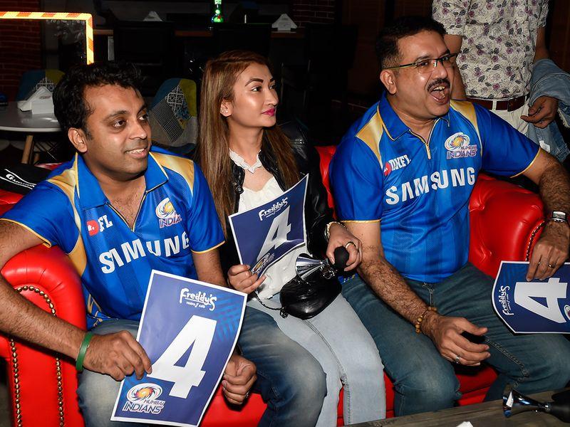 Anxious Mumbai fans watch the action