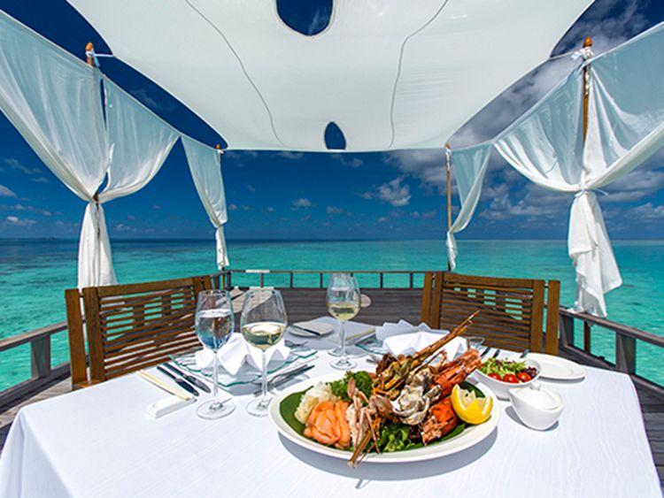 Baros Maldives lunch piano deck