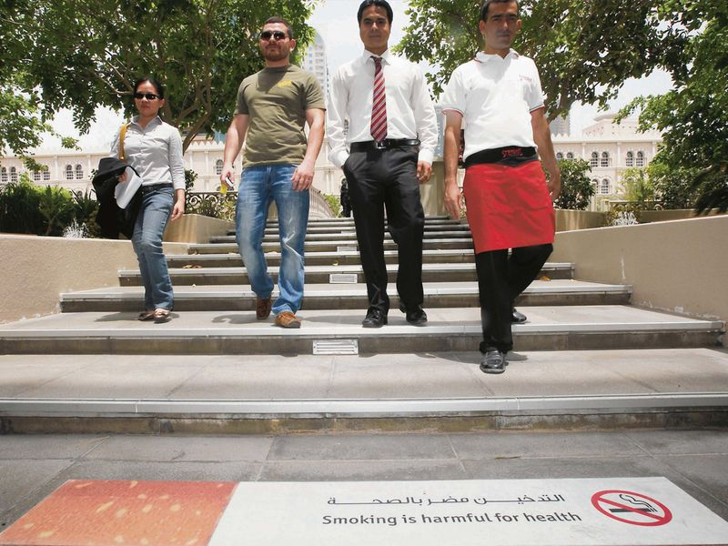 File photograph of anti-smoking awareness posters in the Qanat Al Qasba area in Sharjah.