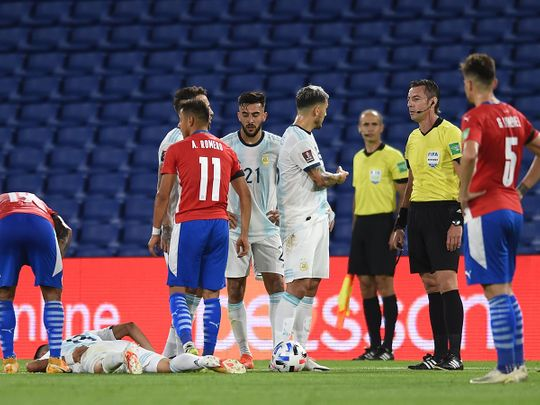 Argentina's Exequiel Palacios lies injured during the World Cup qualifier against Paraguay