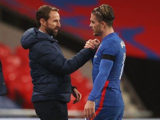England coach Gareth Southgate with Jack Grealish