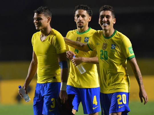 Brazil's Roberto Firmino, right, Marquinhos, and Brazil's Thiago Silva