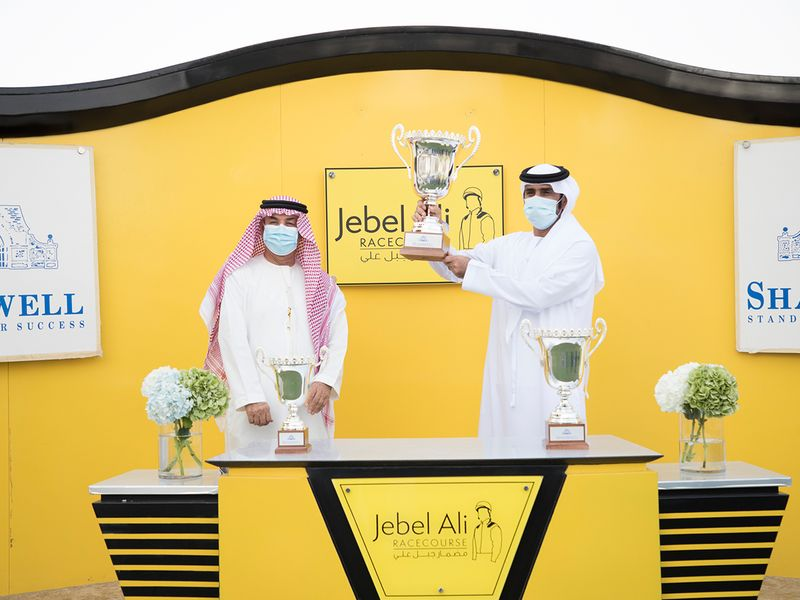 Gabr connections with the Shadwell Condition Stakes trophy at Jebel Ali