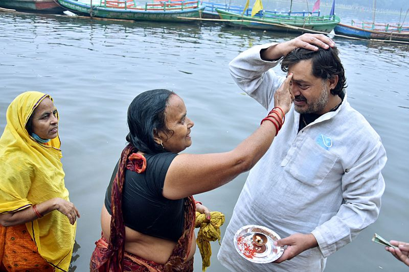 A woman performs rituals