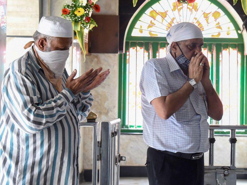 Muslim devotees pray at a shrine in Mumbai.