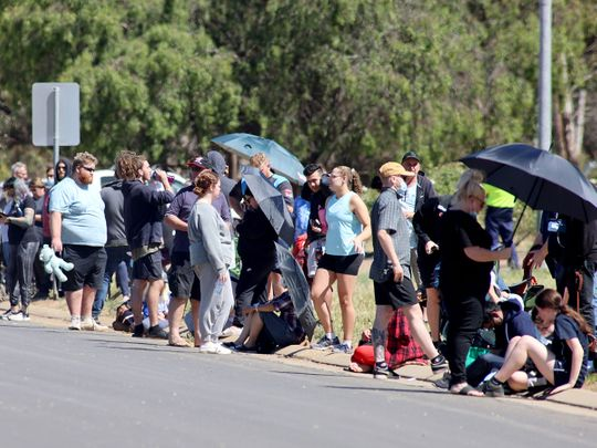 People are seen queuing at a COVID-19 testing site