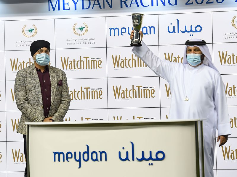 Avtar Singh Deep presenting winners trophy to trainer Musabbeh Al Mheiri after Welsh Lord won the Watch Time race at Meydan