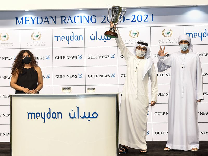 Priya Nair presenting the winners trophy to Saood and Ahmad Al Rahmani after Jayide Al Boraq, won the Bani Yas at Meydan