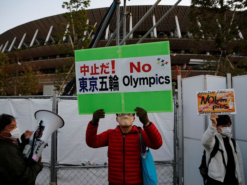 Protestors outside the National Stadium in Tokyo