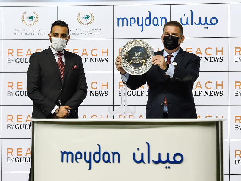 Riaz Rizvi presenting trophy to trainer Doug Watson after Super Chianti won the Reach By Gulf News at Meydan