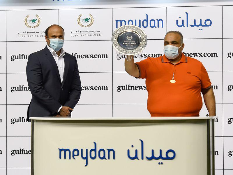 Sandeep Suvarna presenting the winners trophy to owner Nasir Askar after Casey Jones won the gulfnews.com race at Meydan