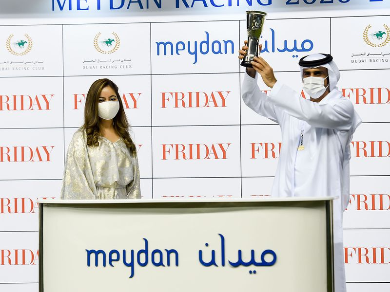 Taruna Sajnani presenting the winners trophy to Salem Al Sabousi after Mayaadeen won the Friday race at Meydan