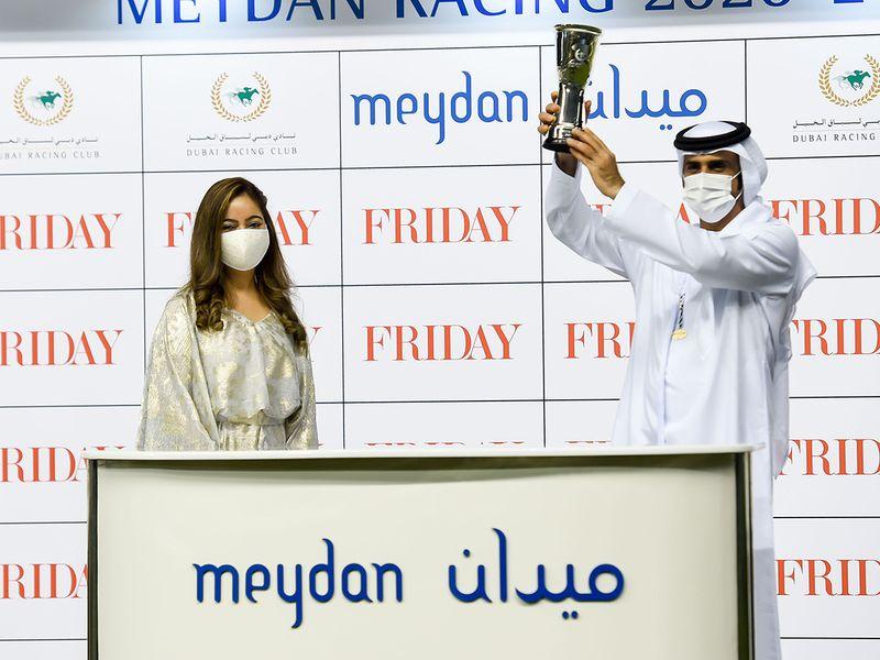 Taruna Sajnani presenting the winners trophy to Salem Al Sabousi after Mayaadeen won the Friday race at Meydan
