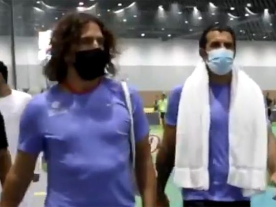 Carles Pyol and Luis Figo arrive for the match in Dubai