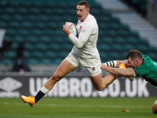 England's Jonny May scores a try against Ireland