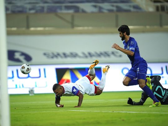 Sarjah's Welliton Soares goes down for a penalty against Al Nasr