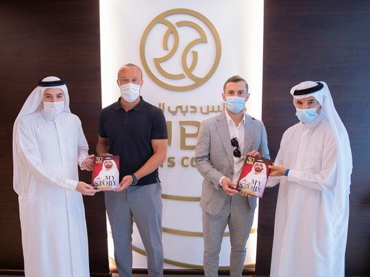 Saeed Hareb, Secretary General of Dubai Sports Council, presents 'My Story' and commemorative medals to Mikael Silvestre and Jack Wilshere at DCS headquarters, in the presence of Nasser Aman Al Rahma, Assistant Secretary General of Dubai Sports Council