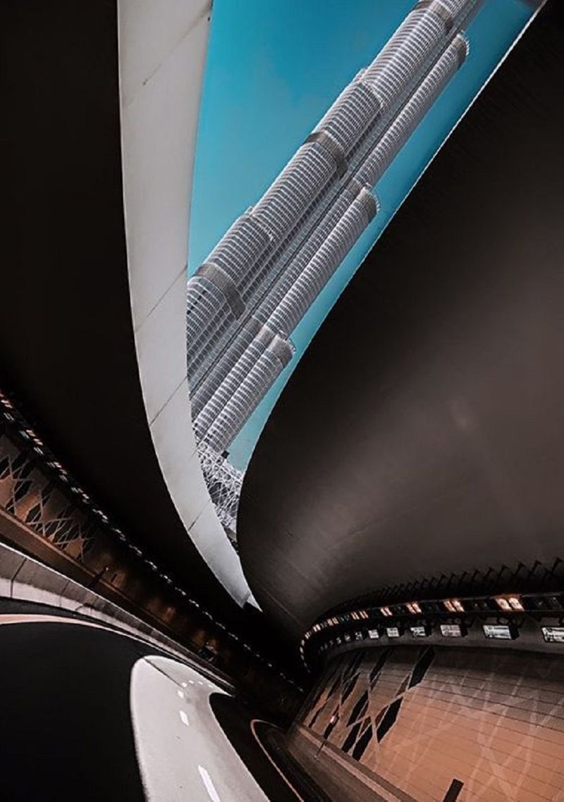The Burj Khalifa in Dubai framed by a gap in a traffic tunnel nearby.
