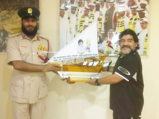 Diego Maradona receives a gift on his visit to Dubai Central Jail in 2011.