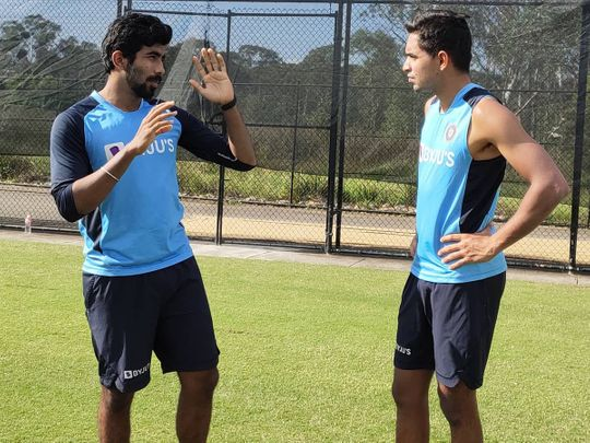 India's Jasprit Bumrah and Kartik Tyagi discuss the finer details during training ahead of the first ODI against Australia on Friday
