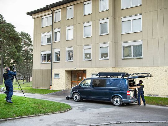 Police at the scene of an apartment