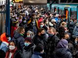 People with face masks stand close together as they wait for a subway train in Frankfurt, Germany, Wednesday, Dec. 2, 2020.