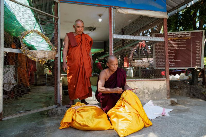 Copy of 2020-12-04T011115Z_820810301_RC21GK9OEW1W_RTRMADP_3_MYANMAR-MONK-SNAKES-1607065178197