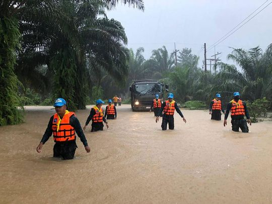 Security forces wading through flood waters