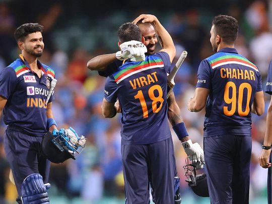 Virat Kohli (2nd L) gives a hug to a teammate Hardik Pandya