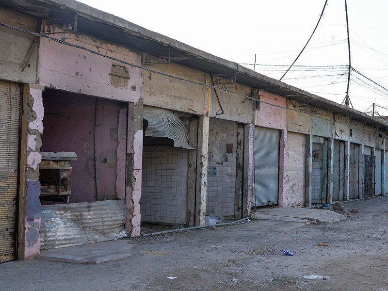 Closed down and damaged shops at the