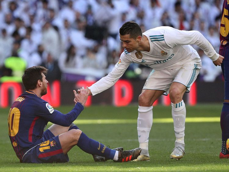 Cristiano Ronaldo helps Messi stand
