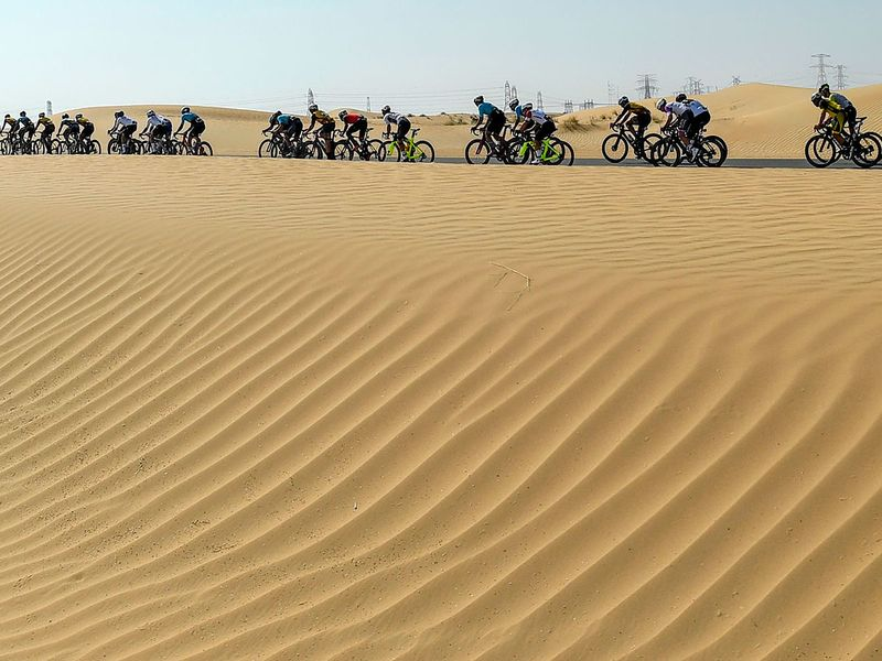 Cyclists compete in the local Al-Silm cycling race.