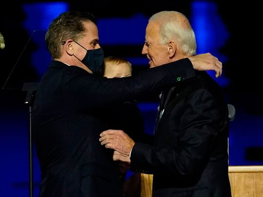 In this file photo taken on November 07, 2020 US President-elect Joe Biden (R) embraces his son Hunter Biden (L) on stage after delivering remarks in Wilmington, Delaware. - US President-elect Joe Biden's son Hunter, a frequent target of Republican attacks during the 2020 election campaign, said December 9, 2020, he is under investigation for potential tax violations.