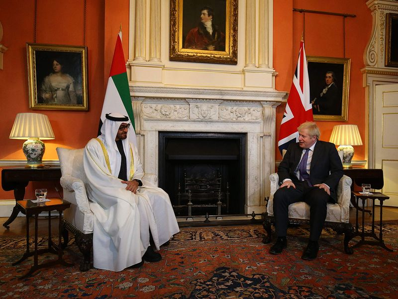 Britain's Prime Minister Boris Johnson (R) talks with greets Abu Dhabi's Crown Prince Sheikh Mohammed bin Zayed al-Nahyan inside 10 Downing Street in central London.