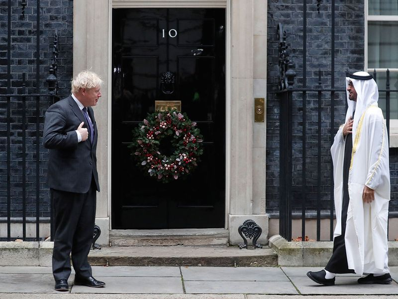 Britain's Prime Minister Boris Johnson welcomes the Crown Prince of the Emirate of Abu Dhabi, Sheikh Mohammed bin Zayed Al Nahyan at 10 Downing Street in London.