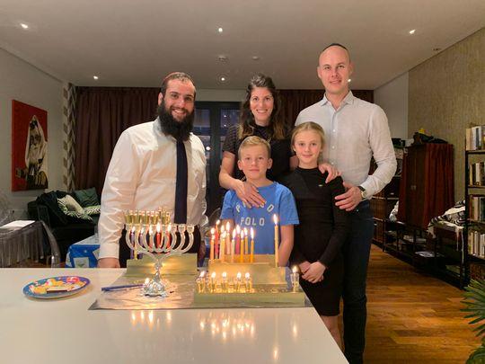 Rabbi Levi Duchman of the United Arab Emirates lighting a Menorah in his home the UAE (December 2019)
