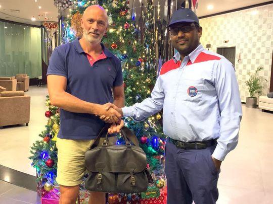 NAT Alan Gardner and taxi driver Firos CK-1607663242114