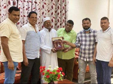 Afi Ahmed (left) said his father UPC Ahmed Haji was happy after being honoured for his social work-1607877852634