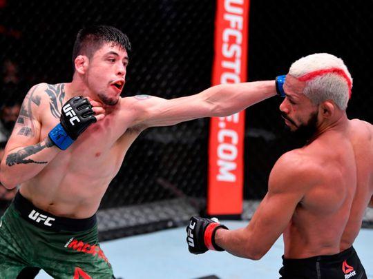 Brandon Moreno of Mexico and Deiveson Figueiredo fight during UFC 256