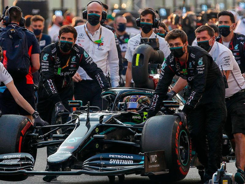 Lewis Hamilton makes his way to the starting grid
