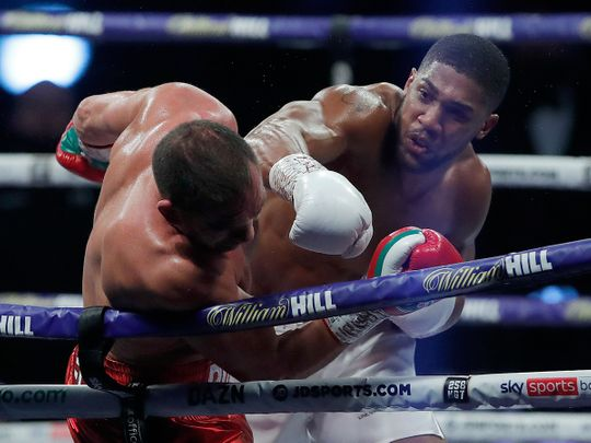 World Heavyweight boxing champion Anthony Joshua lands a blow on Bulgaria's Kubrat Pulev during their heavyweight title fight at Wembley Arena