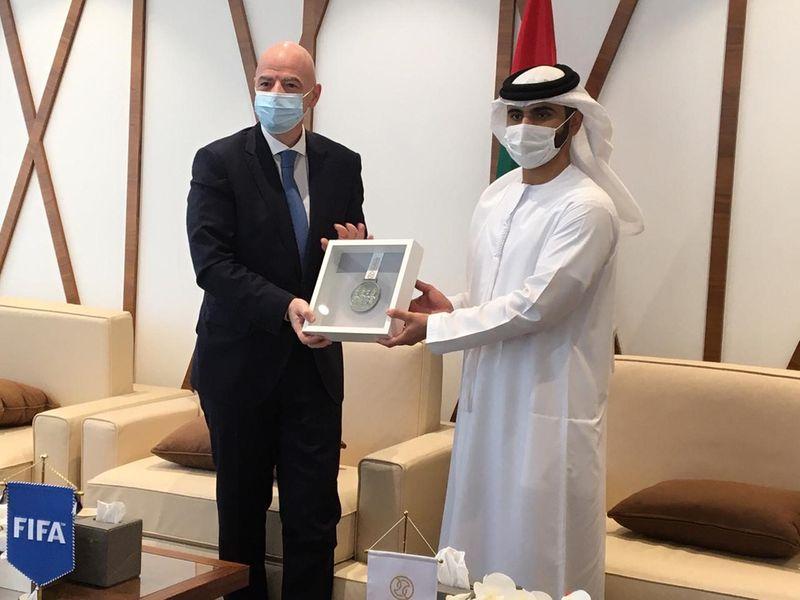 Fifa President Gianni Infantino poses Sheikh Mansoor Bin Mohammed Bin Rashid Al Maktoum, Chairman of DSC, with his medal of honour