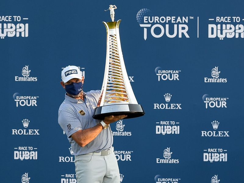 Lee Westwood with the Race to Dubai trophy