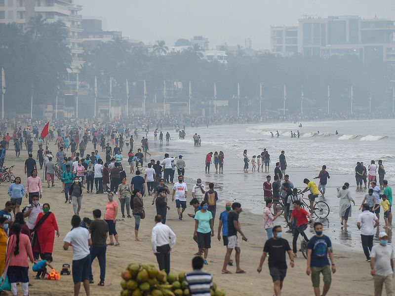 People visit Juhu Beach in the morning hours, in Mumbai