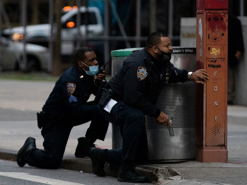 Police officers guard while a man opened fire outside the Cathedral Church of St. John the Divine in the Manhattan borough of New York City, New York, U.S., December 13, 2020.