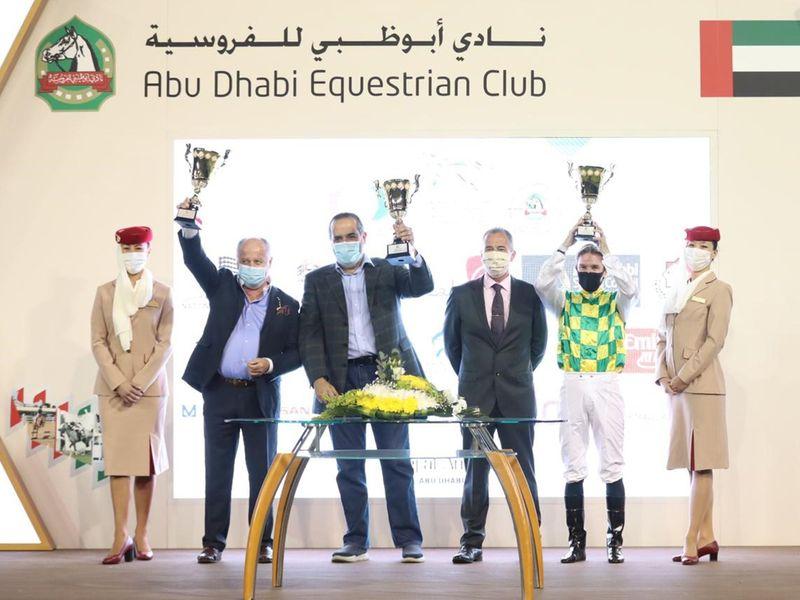 Trainer Jean De Roualle, jockey Richard Mullen, celebrate Heba Al Wathba's win in Abu Dhabi